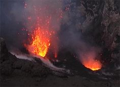 The four eyes of Yasur, Vanuatu. Amazing you can stand on the edge of the crater and watch eruptions.