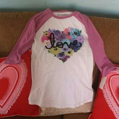 "NWT Floral heart ""Love"" Baseball Tee Purple/white graphic baseball tee with floral heart and ""Love"" graphic. 3/4 sleeves. Very cute and comfortable.  Cotton blend.  Juniors size small- fits tight like xs/s. BRAND NEW WITH TAGS. Stranded Tops Tees - Short Sleeve"