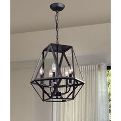 Light up your home with this Joshua 5-light Multangular Iron Chandelier in Antique Black. This 5 -light chandelier is made of iron and features a black finish that will enhance the decor style of your