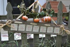 Blogger Lindsay Eidahl used barn wood, cream-colored canvas, gold thumbtacks, raffia, and a chevron ribbon to create this adorable sign for her fence.  Get the tutorial at My Creative Days.