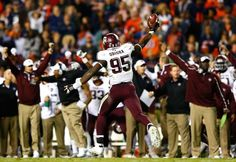 AUBURN, AL - NOVEMBER 08: Julien Obioha #95 of the Texas A&M Aggies reacts after recovering a fumble by the Auburn Tigers on their two-yard line in just under the last three minutes of their 41-38 win at Jordan Hare Stadium on November 8, 2014 in Auburn, Alabama. (Photo by Kevin C. Cox/Getty Images)