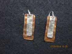 "Hand hammered copper and sterling silver earrings (1.25"") with French wires."