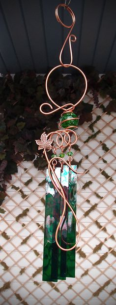 This magical chime was created with a shimmering 1 inch diameter green crackle glass orb nestled within solid hand sculpted copper (a