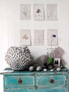 Coastal Style Love the hand-tacked up botanical prints - mixed with a seaside aqua dresser.  Lovely!