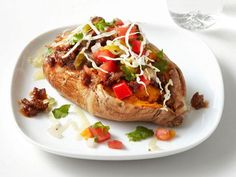 Get Chili-Stuffed Sweet Potatoes Recipe from Food Network