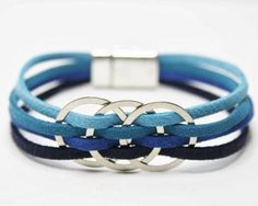 Multi Strand Bracelet for Women, genuine leather bracelet with stainless steel rings and magnetic closure. Handmade genuine leather.  *********** Measure your wrist with a flexible tape measure or a strip of paper just below the wrist bone, where you would normally wear the bracelet. Please do not add extra space when measuring. *********** Made to order, please select a size and color. https://www.etsy.com/shop/DesignedbySeda  Please be aware that the colors you see on your monitor may…