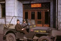 Lt. Harold and Ensign Jerry Walsh of G5 (Civil Affairs), III Amphibious Corps, seated in a Jeep in front of the former German Consulate that served as Bachelor Officers' Quarters, Tientsin, Winter 1946. Amphibious refers to the fact that the Corps could operate on both land and water. Harold Giedt Collection. Old China Hands Archive.