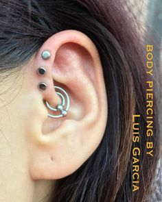 Fresh triple forward helix with @anatometalinc 3mm disks, and healed double daith done 7 years ago.