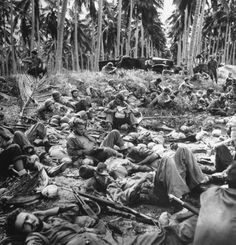 Exhausted US Marines sprawl all over beaches while they wait for their LC to arrive and take them off Guadalcanal. The Marines had been left on the island for four months fighting the Japanese, all with waning supplies and growing wounded before the Army arrived to relieve them.