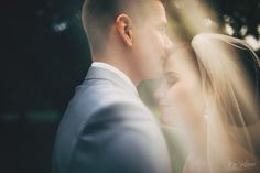 I love to use bridal veil when taking portraits. Bride + groom = love. Wedding Photography by Jere Satamo.