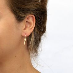 Be bold with these Dangle Wave Earrings. These earrings are made out of brass that has been plated in 14 karat gold - NICKEL FREE! They don't contain any nickel, so you can wear these earrings without worrying about skin irritation.  Handmade from a unique, original design, these drop earrings show an elegant, minimalistic wave design that translates smoothly into a fishhook back. These drop earrings are 1.27 inches long and extend about an inch below the earlobe. These versatile earrings…