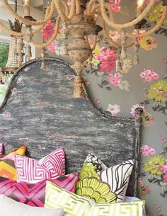wall paper, colors, headboard, and the chandelier