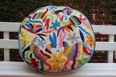 Round Multi Colored Pouf  Ready to ship original by CasaOtomi  Mexico, Tenango, mexican wedding, textile, mexican suzani, suzani, embroidery, hand embroidered, otomi, www.casaotomi.com, otomi, table runner, fiber art, mexican, handmade, original, authetic, textile , mexico casa, mexican decor, mexican interior, frida, kahlo, mexican folk,  folk art, mexican house, mexican home, puebla collection, las flores, travel tote, boho, tote, handbag, purse, cushion, serape