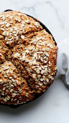 Seeded Whole Grain Soda Bread recipe: This bread is easy as pie—it bakes right in your cast-iron skillet.