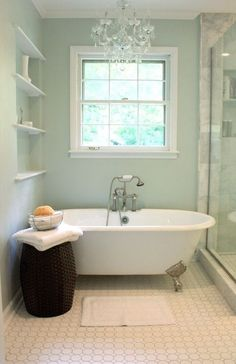 love this small bathroom, claw foot tub, chandelier, aqua, green/blue paint