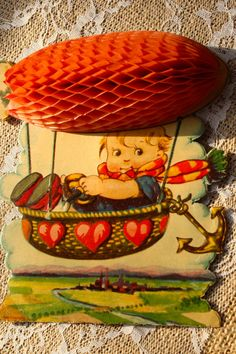 """Adorable vintage 1920's valentine.    """"I am up in the air about you My Valentine""""    Little boy in an airborne basket under a blimp that is honeycomb tissue that locks in place with a metal grip clasp over the words.    Made in Germany.    No envelope.    ~We add new unique items often.    Monique and Anita would like to thank you for visiting to day! Come back soon! 