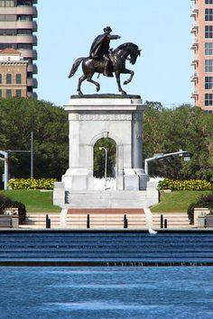 Sam Houston's statue points toward the Houston Zoo and the Medical Center, astride his loyal steed in Hermann Park. A fun place to take family photos, there is a light rail stop nearby serving Hermann Park, the Zoo, and Rice University - Parking can be tough, so I would park on the rail line somewhere and take the train to the park for the day.