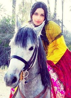 Qashqai Lor lady. Men and women of this tribe, as well as other nomads in Iran, are excellent riders. Both genders move, work and practise tough equestrian games and competitions.