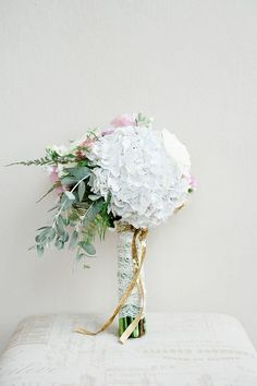 Totally Dreamy Pastel and Gold Pretoria Wedding Bouquet Recipe: White Hydrangea, Eucalyptus leaves, peach, lavender and cream roses, white lisanthius, ferns and wildflowers / D'amor Photography http://www.confettidaydreams.com/pastel-gold-pretoria-wedding/
