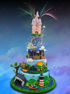 Disney cake! Each tier is a different ride/event at Disney World!