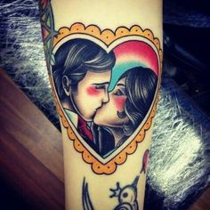 Kissing couple in a heart tattoo