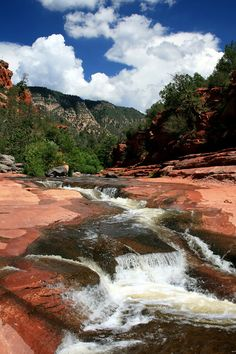 Slide Rock State Park is a state park of Arizona, taking its name from a natural water slide formed by the slippery bed of Oak Creek. The park is located in Oak Creek Canyon 7 miles north of Sedona.