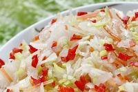 Cortido (Latin America Sauerkraut). 1 large cabbage, cored and shredded 1 cup grated carrots 2 medium onions, quartered lengthwise and very finely sliced 2 garlic cloves, minced (optional) 1 tablespoon dried oregano ¼-½ teaspoon red pepper flakes 1-3 tablespoons sea salt