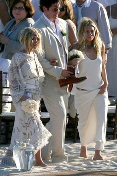 Mary-Kate and Ashley Olsen at a beach wedding. #weddinginspiration #olsentwins