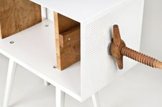 """Slovak Mejdstudio designers have put their own """"twist"""" on a bookcase during the summer workshop 'lost and found' organized by CA flowers for slovakia in cooperation with swiss furniture company Vitra. Twist Me is a book shelf which stands off the ground on elegantly crafted tapered legs holding your literature in a sandwich style between a hardy wooden clamp. Adjust the width  by simply twisting the sides. Encased in an airy metal crate fashioning pinholes throughout."""
