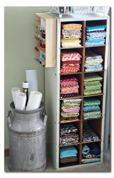 Fabric stash with side storage and a dish drainer on top to hold rulers, books, etc - see other pin