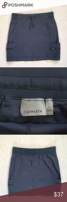 """Athleta Blue Trekkie Drawstring Pockets Skort 0 Blaze a new trail in this wicking ripstop hiking bottom that has 2-way stretch for ease of movement and a casual style that transcends the trail. ultra-comfy rib-knit waistband is daypack-friendly BUILT-IN SHORT.  Pockets: 2 front hand pockets plus zip pockets Nylon/Spandex Machine wash and dry. Semi-fitted, Mid-rise, Straight leg Sits two fingers below the navel, skims over the body for a just-right fit. 15"""" length.  Excellent condition…"""