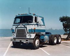 Color advertising photograph of an International Transtar semi-truck parked along a waterfront. Navistar International, International Harvester Truck, Cool Trucks, Big Trucks, Farm Trucks, Truck Transport, Diesel Cars, Diesel Vehicles, Cab Over