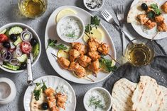 Salmon skewers and rice - healthy lunch table. grilled salmon fish skewer on a dark Salmon Skewers, Chicken Skewers, Grilled Salmon, Grilled Meat, Greek Recipes, Wine Recipes, Popular Greek Food, Souvlaki Recipe, Greek Chicken Souvlaki