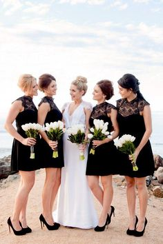 Black and white wedding- bridesmaids in black with white bouquets