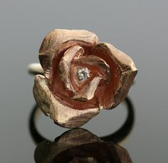 NOT for an engagement ring, but I LOVE this.    Vintage 14K Rose Gold Rose Petal Ring. $895.00, via Etsy.
