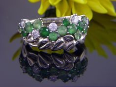 Hand carved wreath shadow band to fit custom made diamond and emerald engagement ring