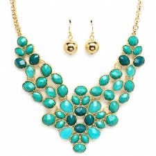 this is a coral blue necklace with delicate gold ball earrings. you could wear this to a party or wear it to make a good impression of yourself to a special someone. this can add some color to your outfit and style.