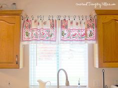 Ideas for Decorating Windows with Curtains: Good Housekeeping __ This handmade version was created with a tablecloth and shower curtain clips.