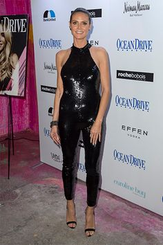 b912a544b66 Heidi Klum in a Saint Laurent Sequined Stretch-Mesh Jumpsuit https   api