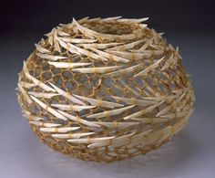Urchin III, 2002; needle lace, hog casings, goose quill toothpicks; 6.75 inches high, 8.75 inches in diameter.