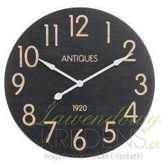 Duży zegar w stylu prowansalskim o czarnej tarczy i średnicy aż 81,5cm.