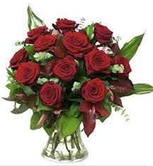 Dark Red Roses With Glass  http://www.a1ahmedabadflowers.com/