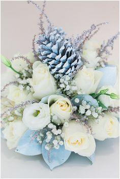 Winter wonderland flowers by Mayflower Flower Shop  Festive Table Styling – {Rustic Chic}