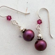 Pearl Earrings that match the wedding colors. I need to start adding them into my attire as well.