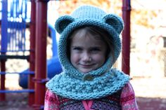 Not all those who wander are lost ~ Tolkien  The Wee Wanderer:  An adorable child-sized version of my Wanderer Mantle, the Wee Wanderer is a combination hood and cowl, perfect for winter weather play and activities for both boys and girls alike. Hand knit using 100% soft wool roving, this garment is extremely warm and comfortable. Slips over the head and the hood can be worn up or down. Completed with a button for fastening the front of the hood and large teddy bear ears for an added touch…