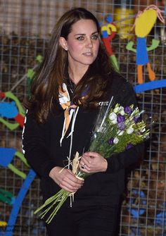 """Catherine, Duchess of Cambridge visited the newly established 23rd Poplar Beaver Scout meeting at Old Ford Primary School to support The Scout Association's """"Better Prepared"""" campaign on December 16, 2014 in east London, England."""
