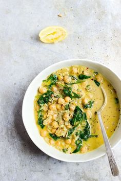 Coconut Curry Chickpeas with Wilted Greens | Vegan, naturally gluten-free coconut curry chickpeas with wilted greens. Coconut curry chickpeas made in under 15 minutes. Quick, easy, weeknight meal.