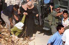 A #Palestinian woman falls as #Israeli soldiers try to prevent worshipers from passing the checkpoint between #Bethlehem and #Jerusalem in order to pray at the Al-Aqsa Mosque for the second Friday of the holy month of #Ramadan. #apartheid #idf #freepalestine #zionismisterrorism #bds #endisraeliapartheid