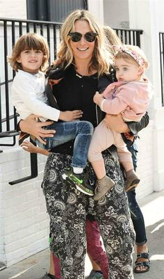 Molly Sims holds onto her kids Brooks and Scarlett after a lunch date in Los Angeles on May 16, 2016.