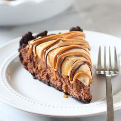 Chocolate Peanut Butter Caramel Mousse Pie made with an Oreo crust, chocolate caramel mousse filling, and peanut butter whipped cream to top. Decadent!